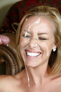 This blond is so happy to have this much load on her face